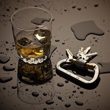 Alcohol and keys on wet surface